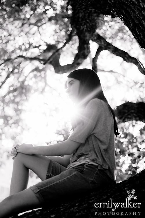 Sister outside in tree.